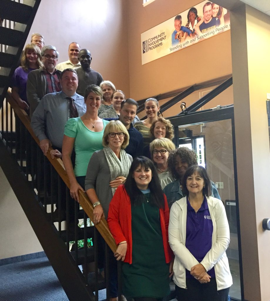 A picture of CIP's staff and the staff from CQL on the steps at CIP together.